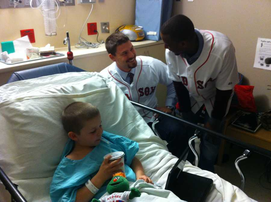 Red Sox catcher Ryan Lavarnway & infielder Pedro Ciriaco visit with a young patient at Fletcher Allen Health Care.
