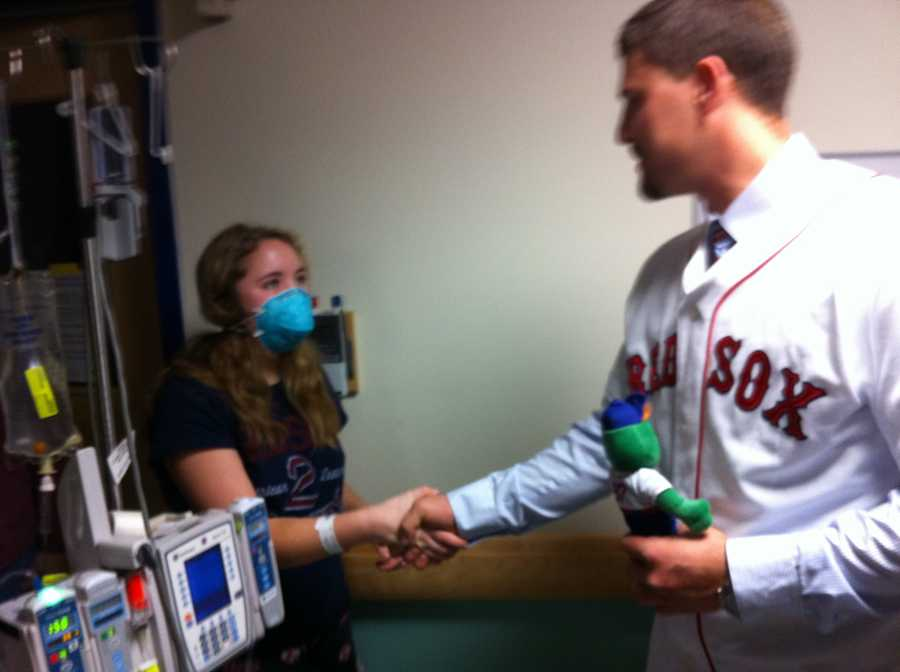 Ryan Lavarnway shakes hands with a young patient at Fletcher Allen.