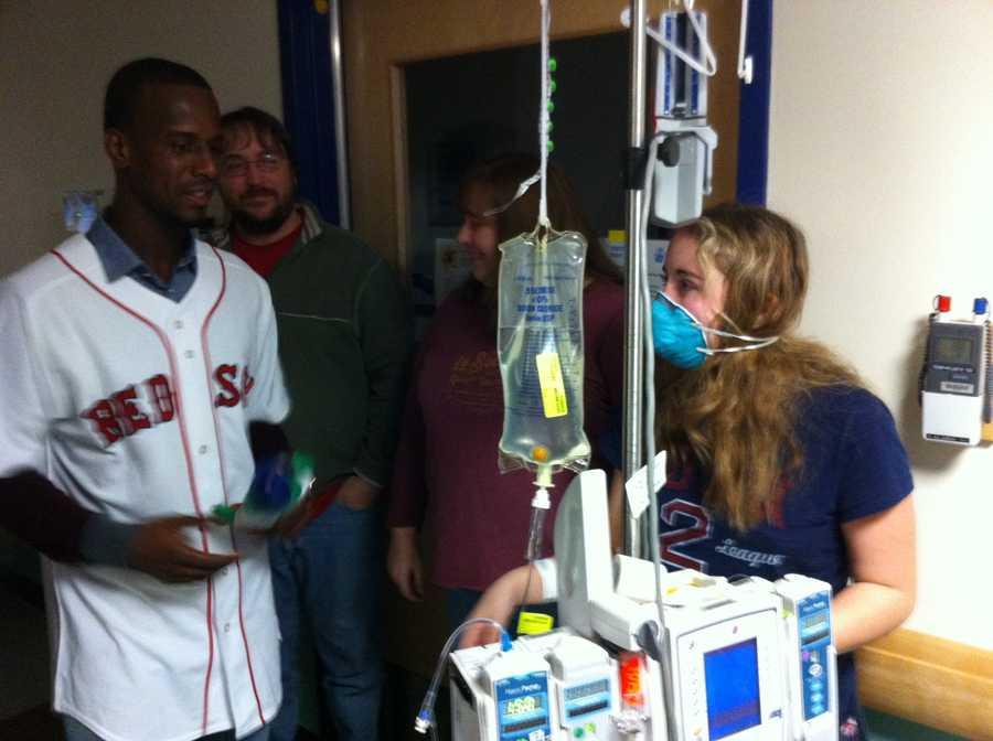 Pedro Ciriaco visits a young Fletcher Allen patient.