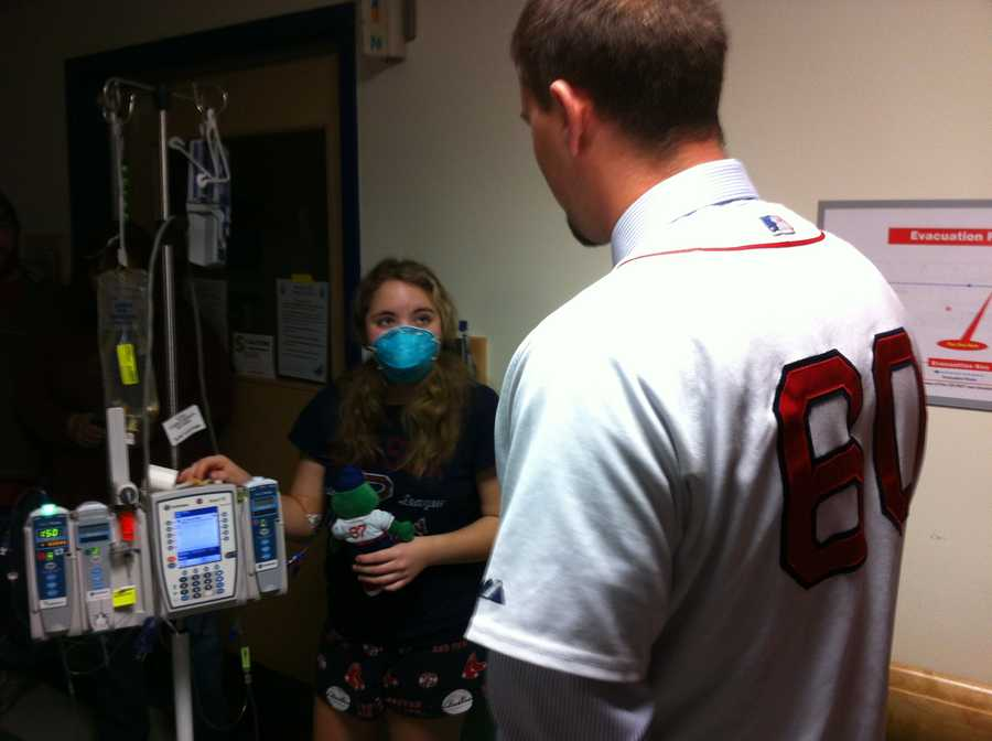 Ryan Lavarnway chats with a young patient at Fletcher Allen