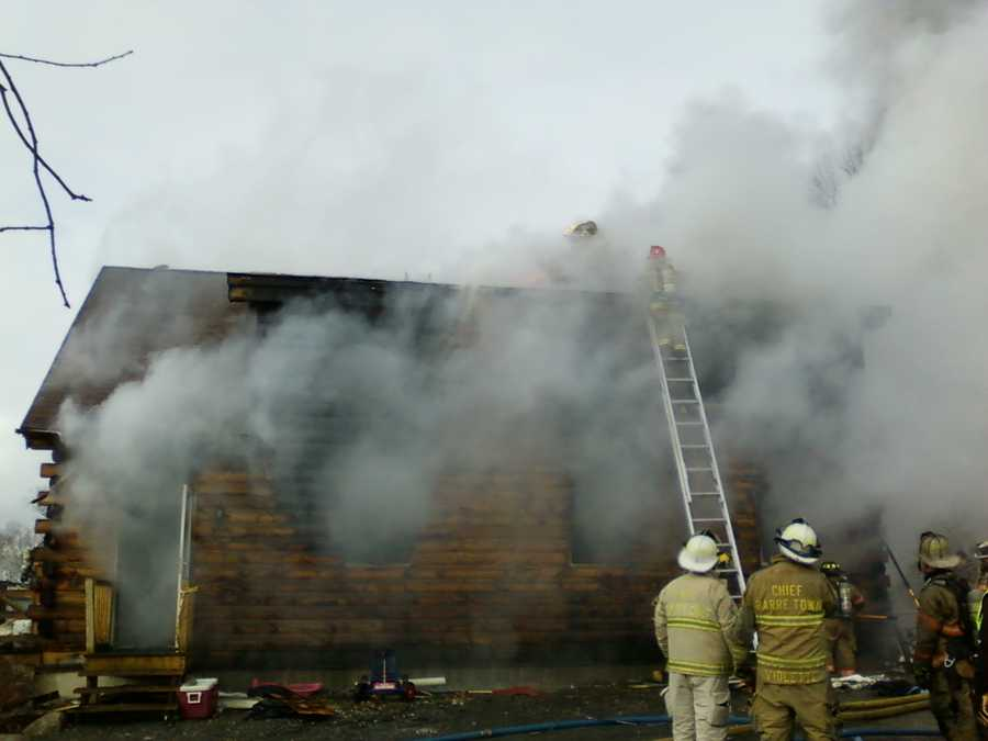 Firefighters work to extinguish the fire at a Barre home.