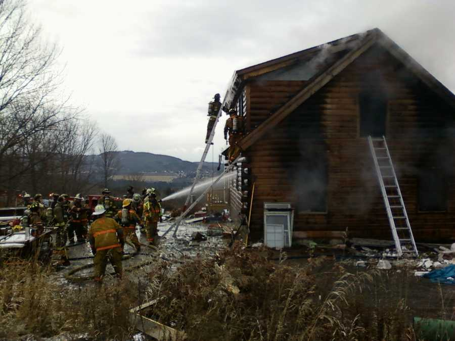 Firefighters spray down a Barre home.