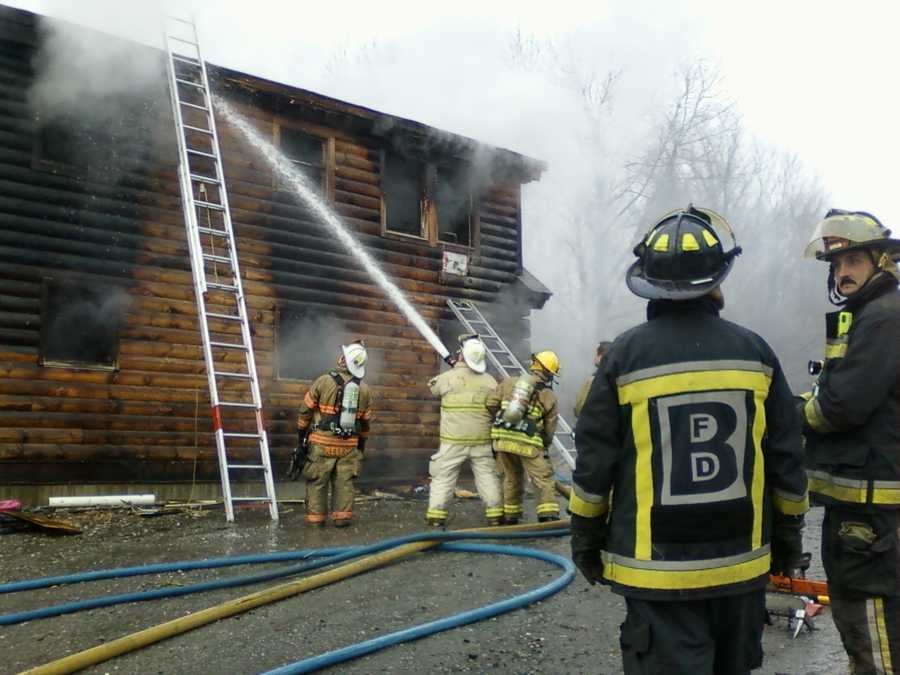 Firefighters douse a home on Phelps Road in Barre.