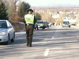 A Vermont State Trooper inspects the Route 7 scene where Rep. Greg Clark was killed after being struck by a car.