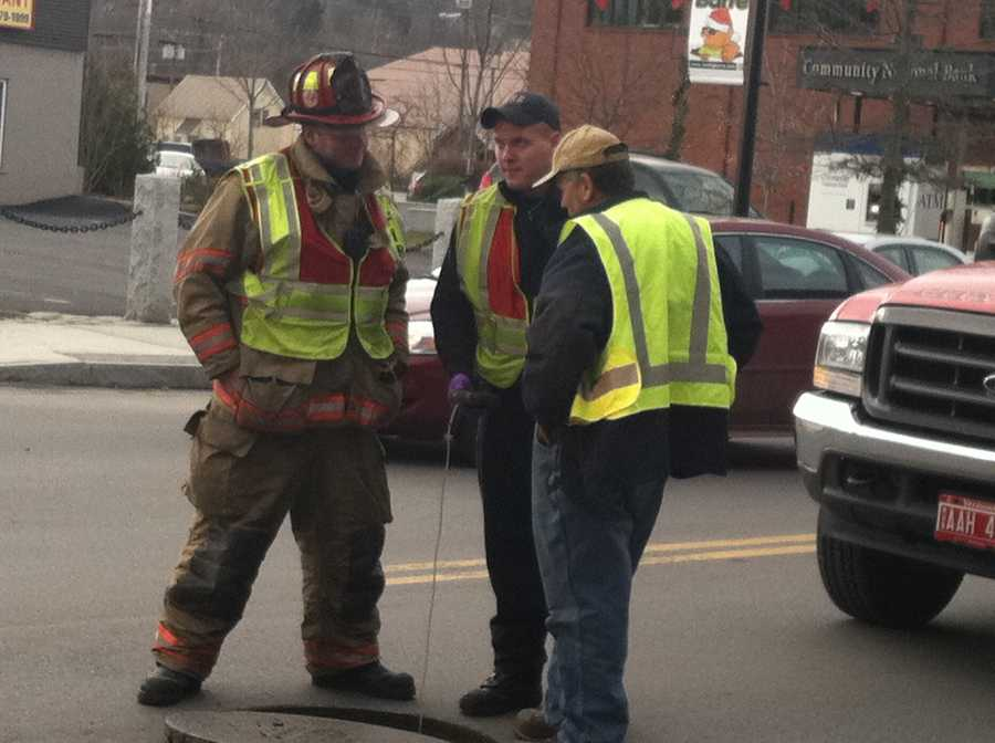 Officials test the combustible level of the sewer system in Barre.
