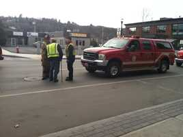 Officials remove manhole covers.