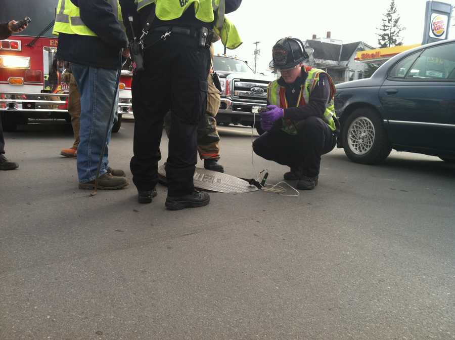 Officials test the sewer system for gasoline.