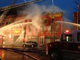 Five departments across the Northeast Kingdom fight a fire at 430 & 438 Railroad Street in St. Johnsbury on Sunday, Dec. 23.