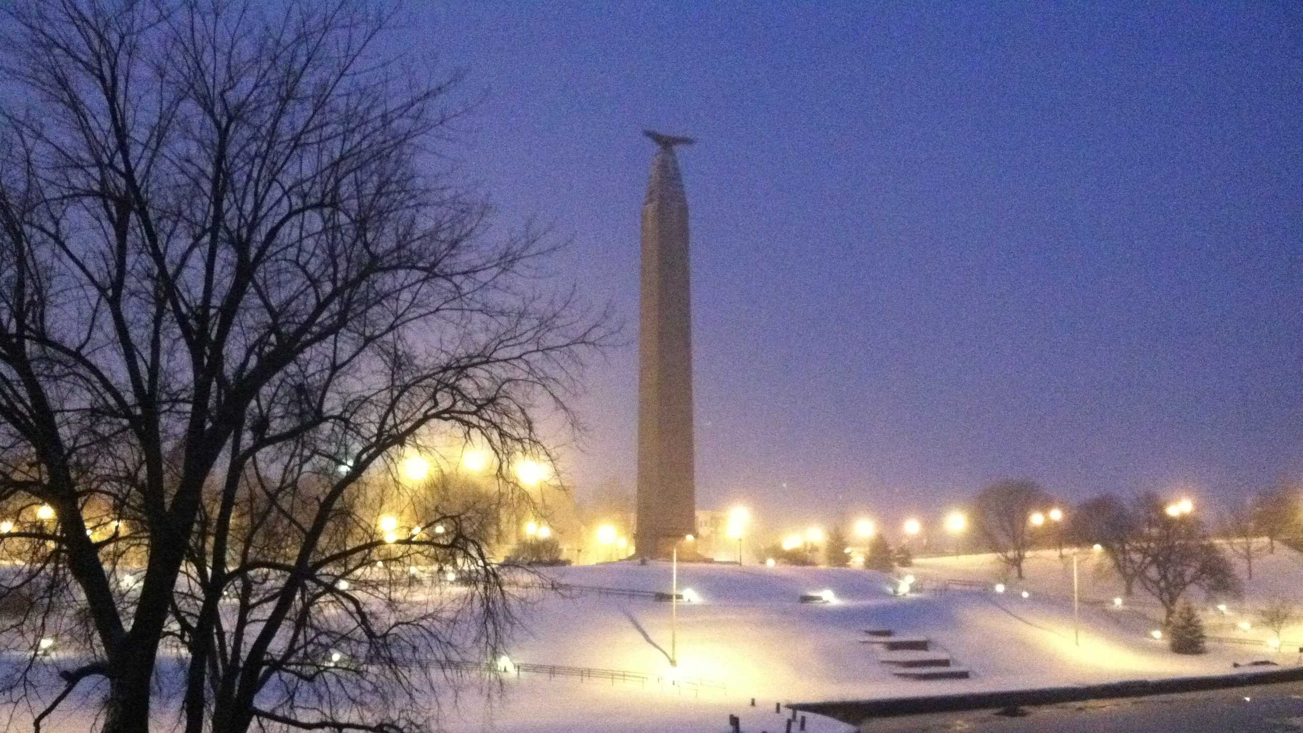 The monument is now surrounded by white as the snow began to fall early this morning.