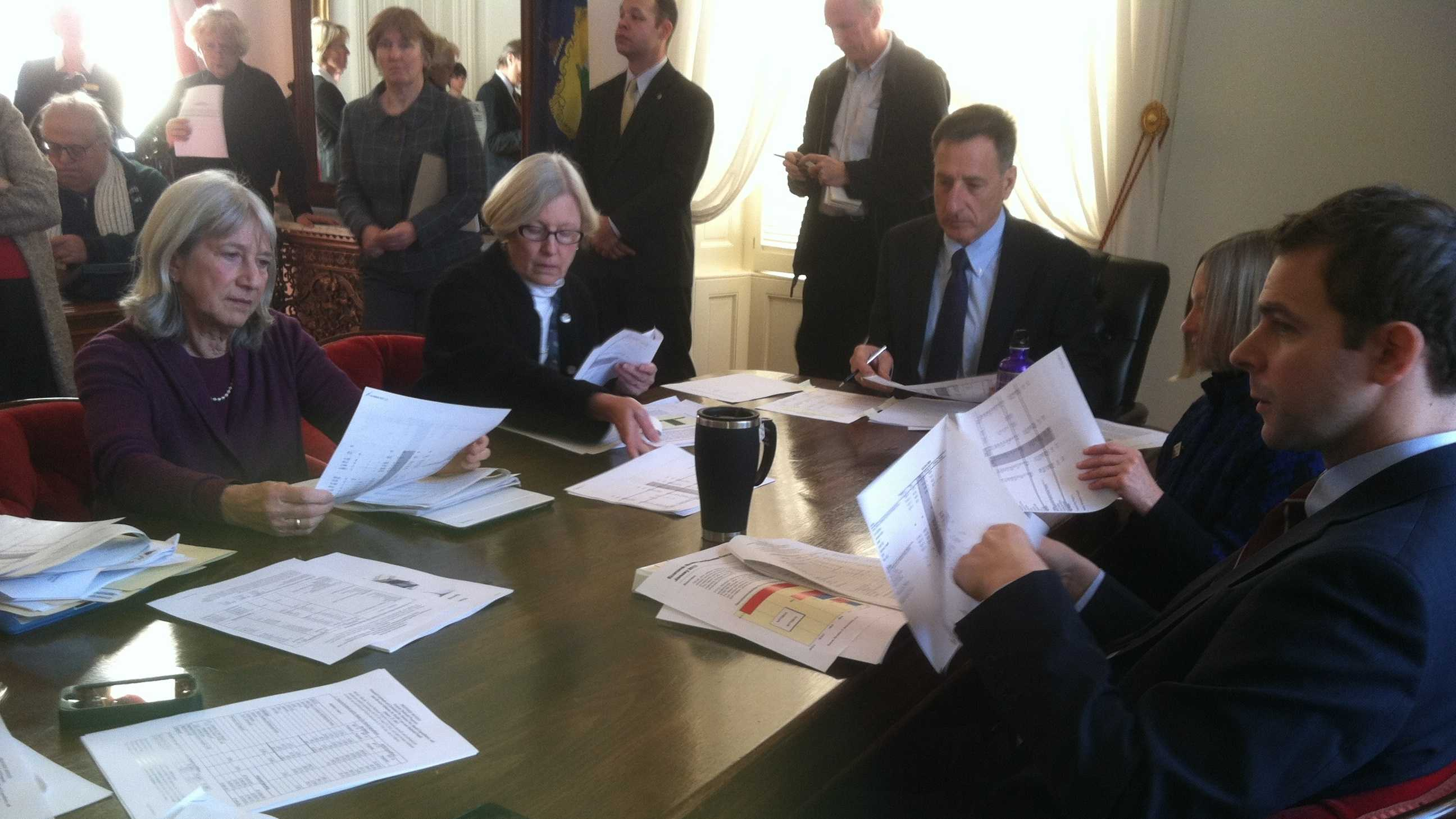 Gov. Peter Shumlin and lawmakers who comprise the state Emergency Board listen to presentations from state economists Wednesday.