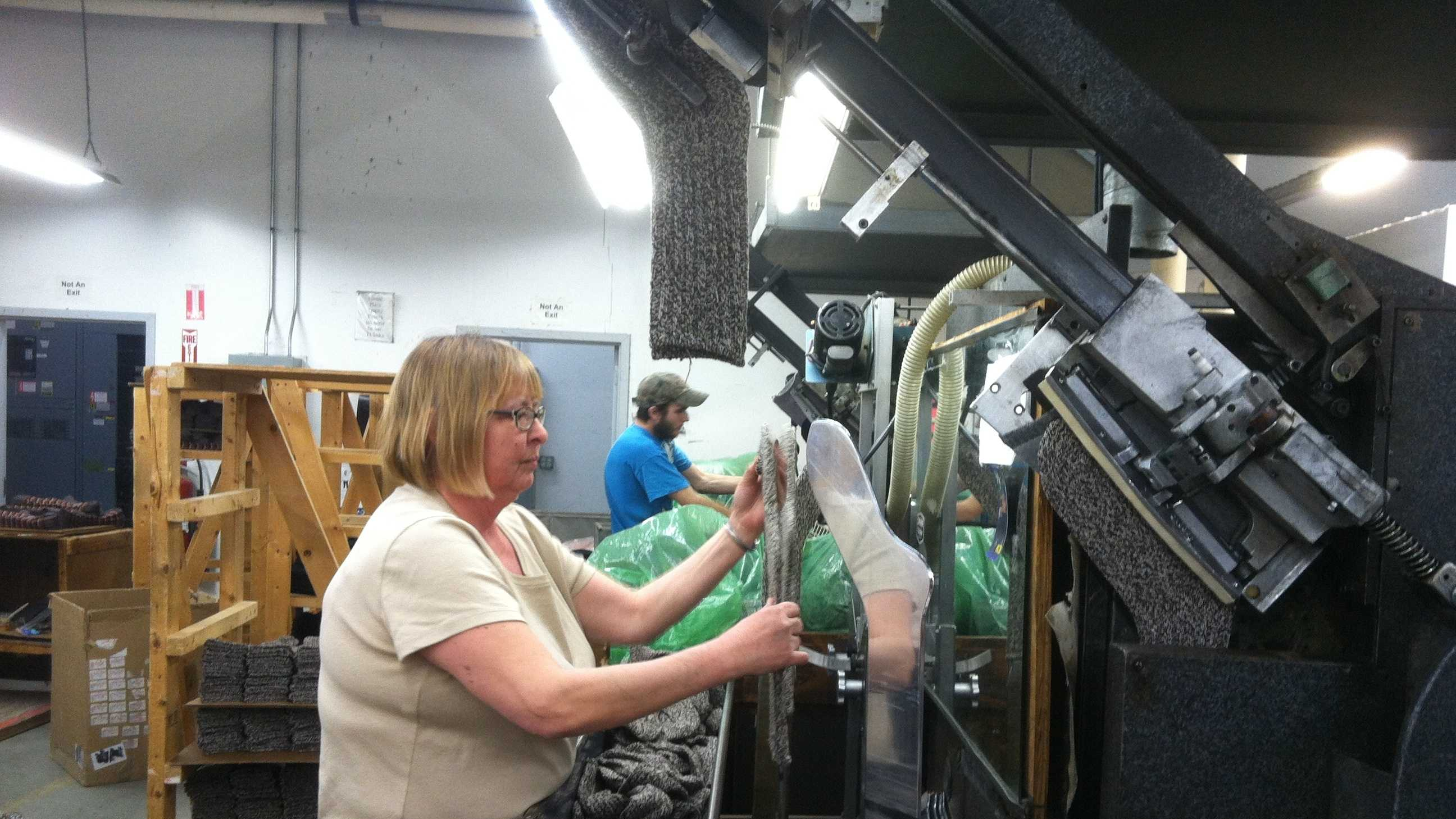 Lisa Morey, a 22 year veteran at Cabot Mills, says loves her work at a company that 'treats me well'.