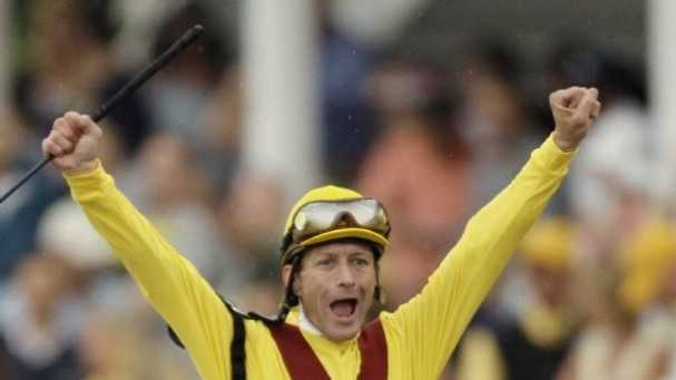 Jockey Calvin Borel celebrates in the irons after Rachel's impressive victory over Kentucky Derby winner Mine That Bird in the 2009 Preakness Stakes