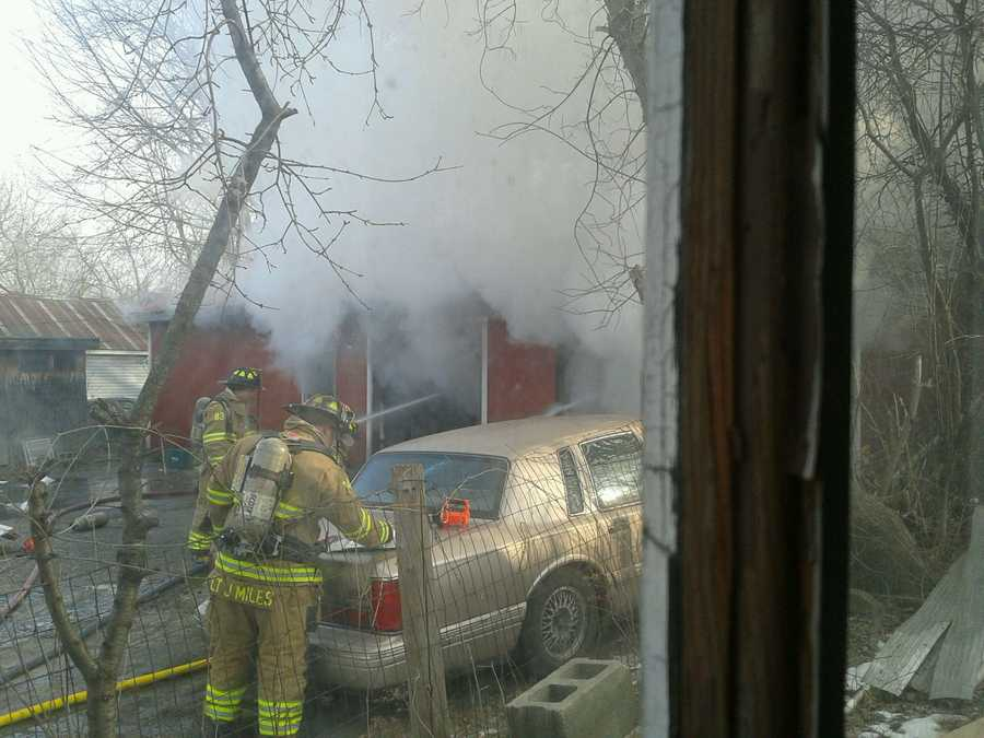 Fire fighters on the scene of a fire at a gun shop on Elm Street in Rutland. The gun shop is housed in the owner's garage.