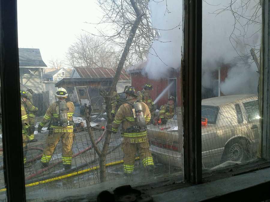 Fire fighters extinguish the fire at a Rutland gun shop.