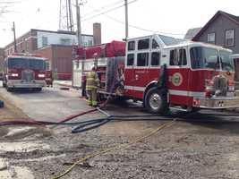 Fire crews respond to a fire at a gun shop in Rutland.