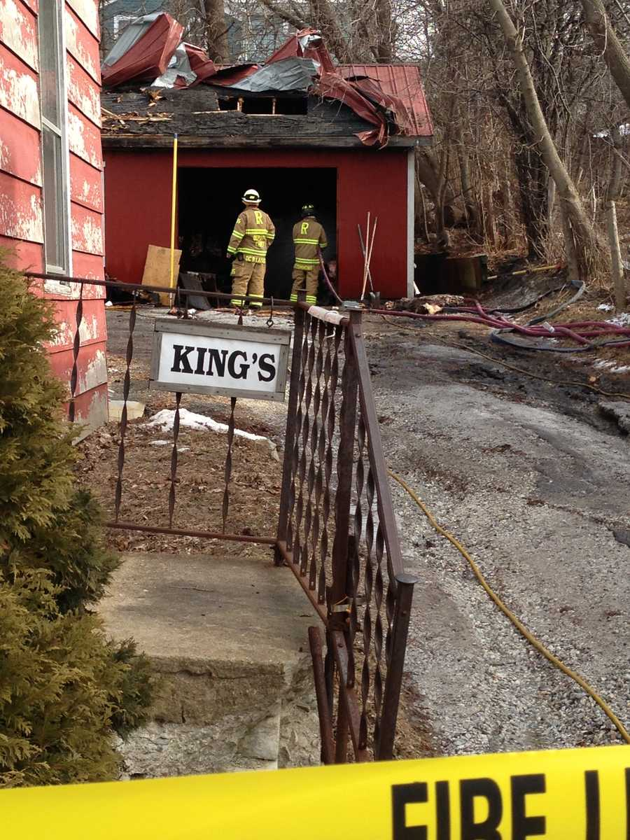 Fire crews are cleaning up the debris from a fire that leveled a Rutland gun shop.