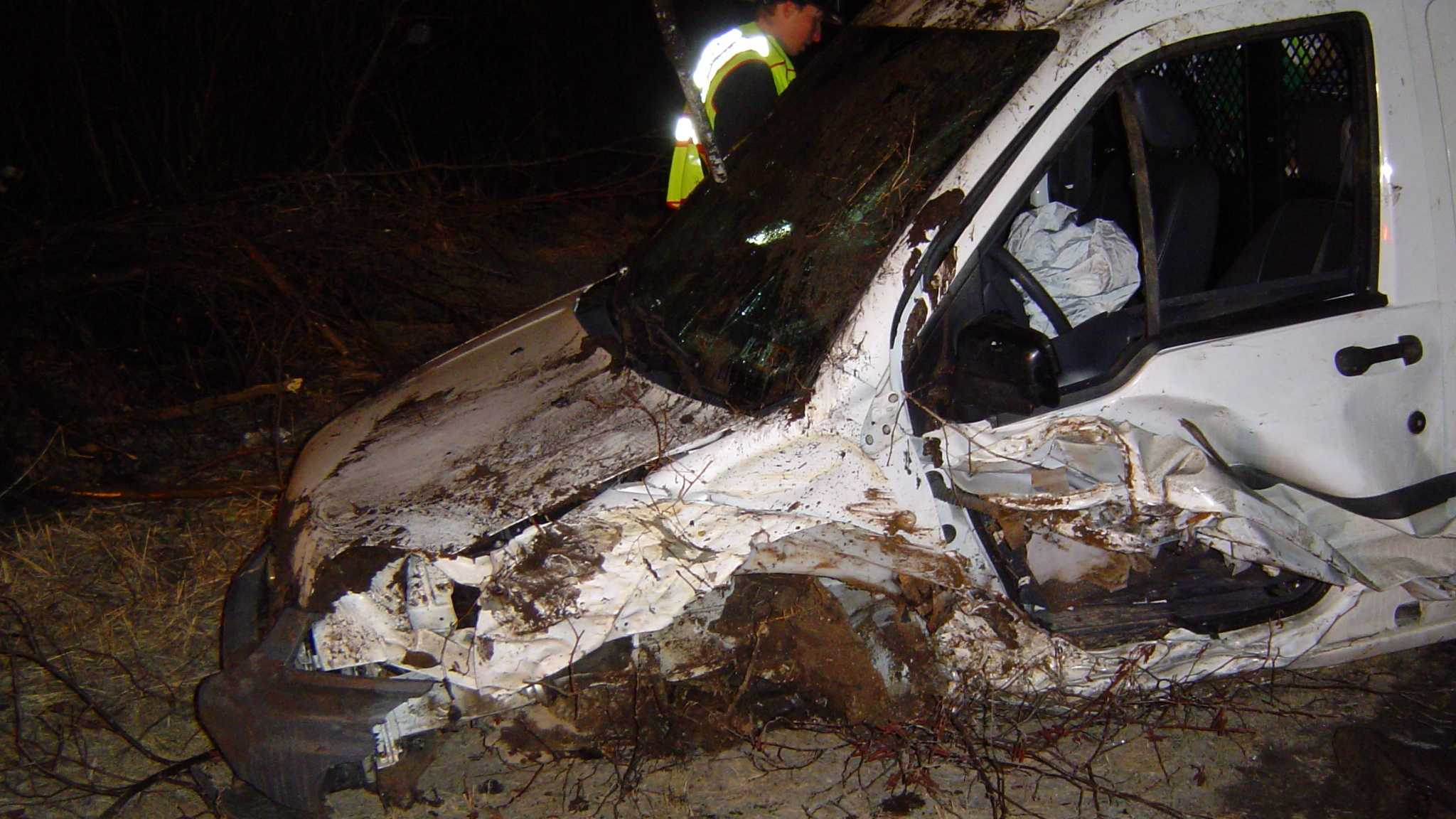 03-31-13 Car rolls over into woods - img