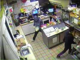 The suspect is seen leaving the store.