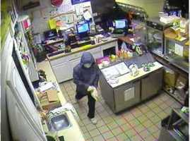 Another look at the suspect as he leaves the store.