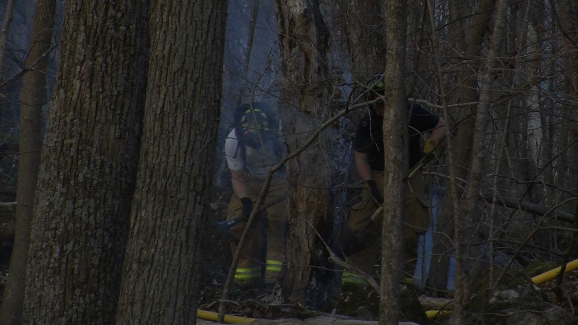 Malletts Bay, Colchester and Winooski firefighters battle a brush fire on Marble Island.