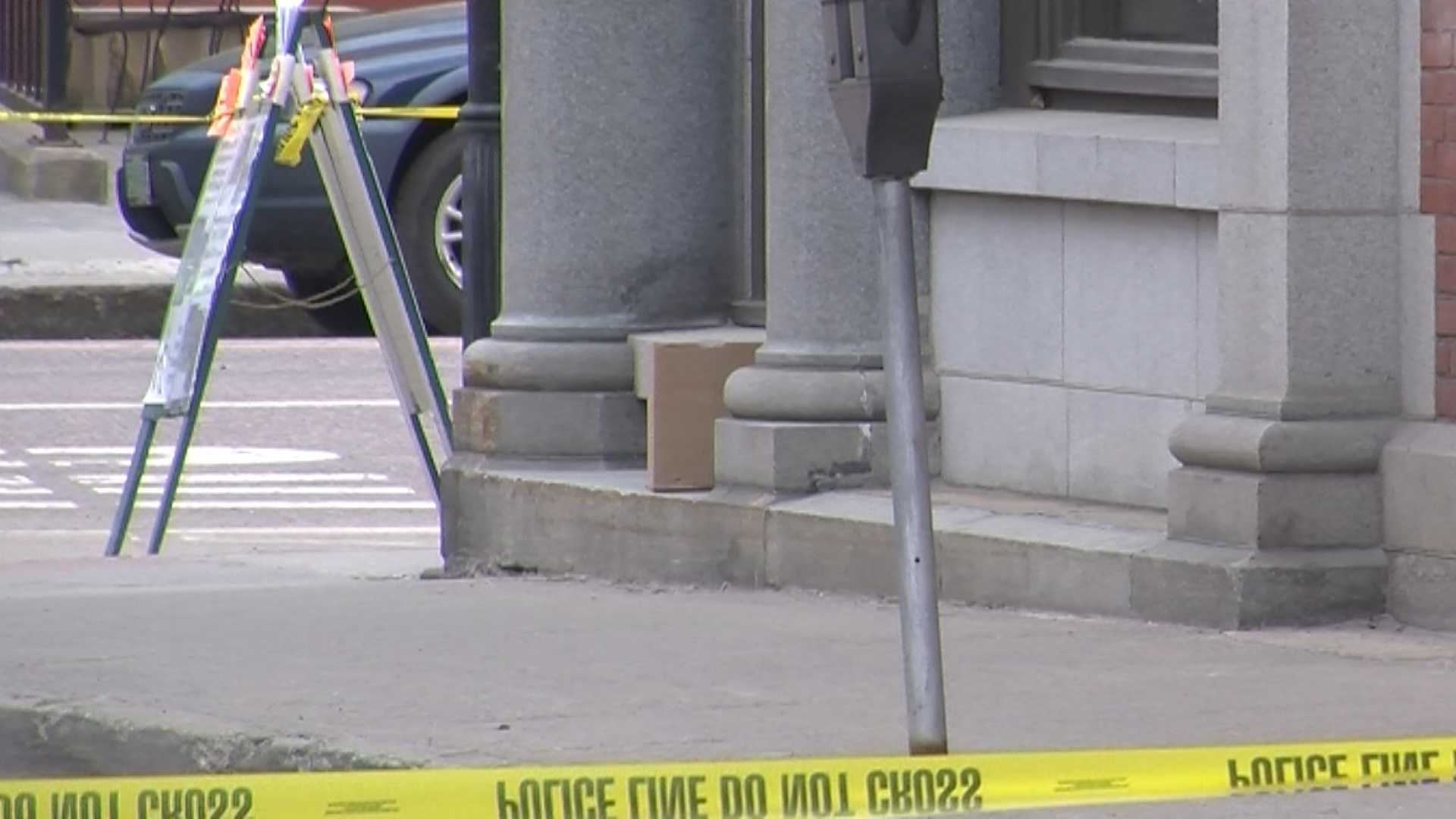 Police inspect a suspicious package left on a windowsill at the T.D. Bank in Montpelier.