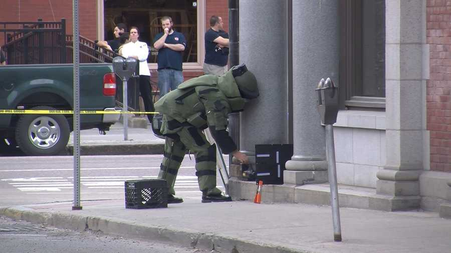An officer sets up to x-ray the box.