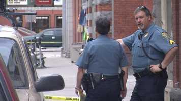 Police stand on Langdon Street.