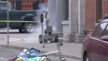 The bomb squad explodes the cardboard box.