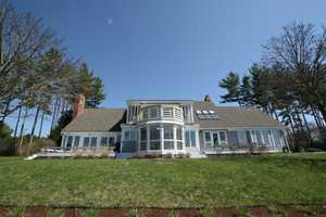 "Three hundred and thirty five feet of West facing Shelburne Bay lakefront on 1.86 acres. This 4,000 sf (=/-) classic New england Cape opens wide to a remodeled kitchen featuring a large granite island, 36"" Blue Star Range, and Heath Ceramic backsplash."