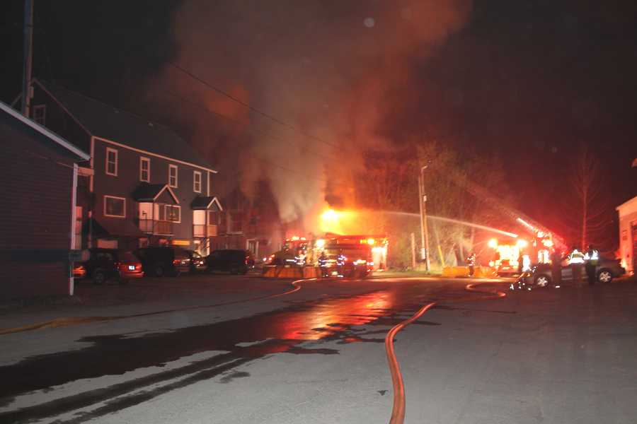 Three Vermont firefighters were injured when a tank of welding gas exploded during a fire that destroyed a home and art gallery in Morrisville. Photos courtesy of Mickey Smith/News & Citizen.