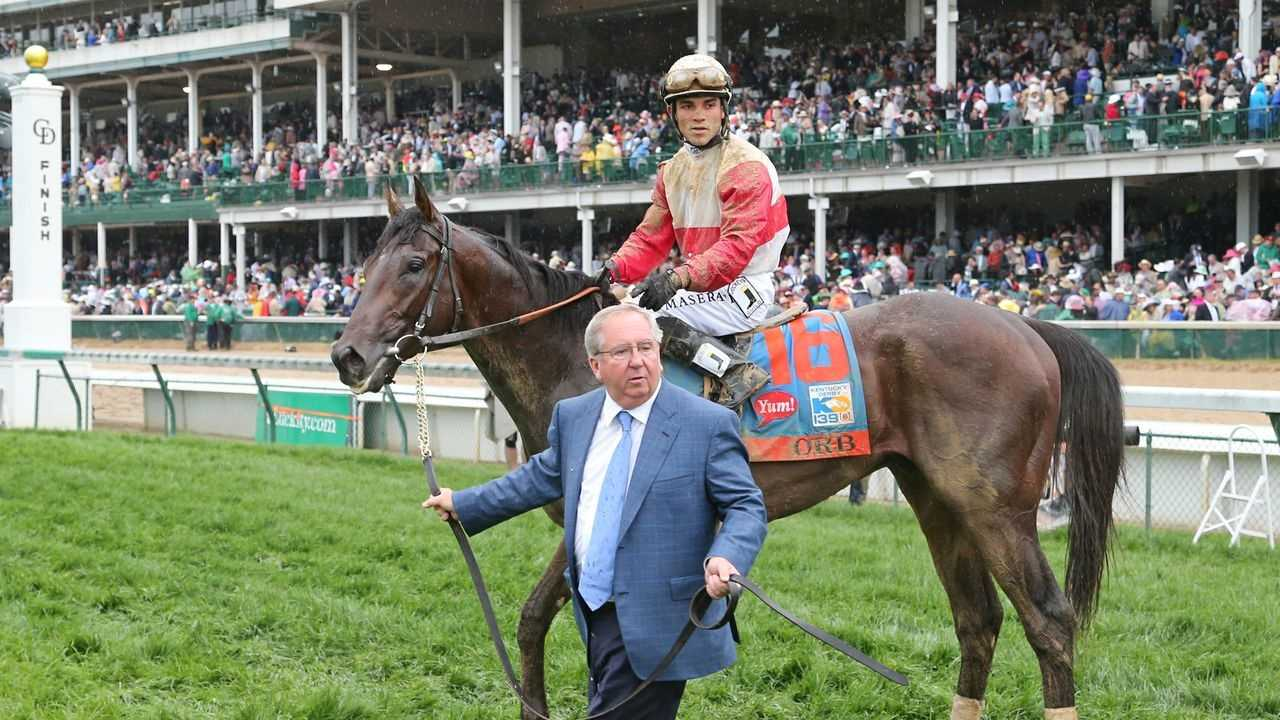 Orb with trainer Shug McGaughey and jockey Joel Rosario following the Kentucky Derby.