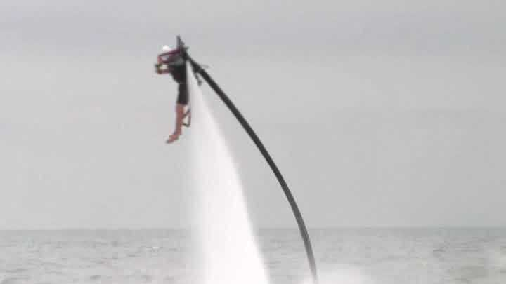 A new attraction at a South Carolina beach lets people fly above the ocean with a jetpack.
