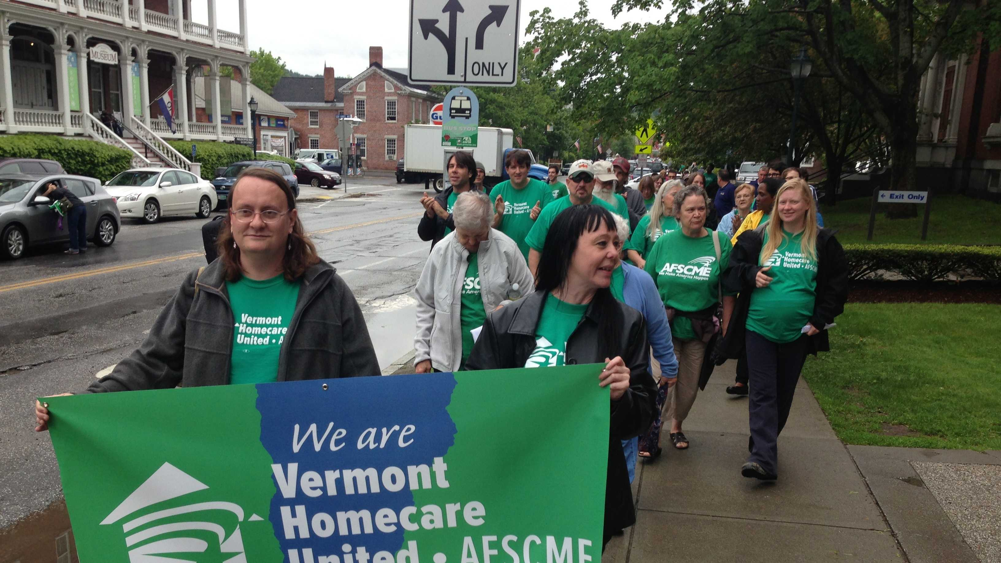 Supporters of the American Federation of State, County and Municipal Employees union march through Montpelier Wednesday.