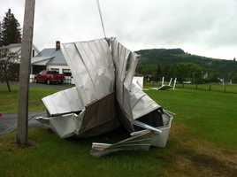 Roof wrapped around pole on Pleasant Street in St. Johnsbury.