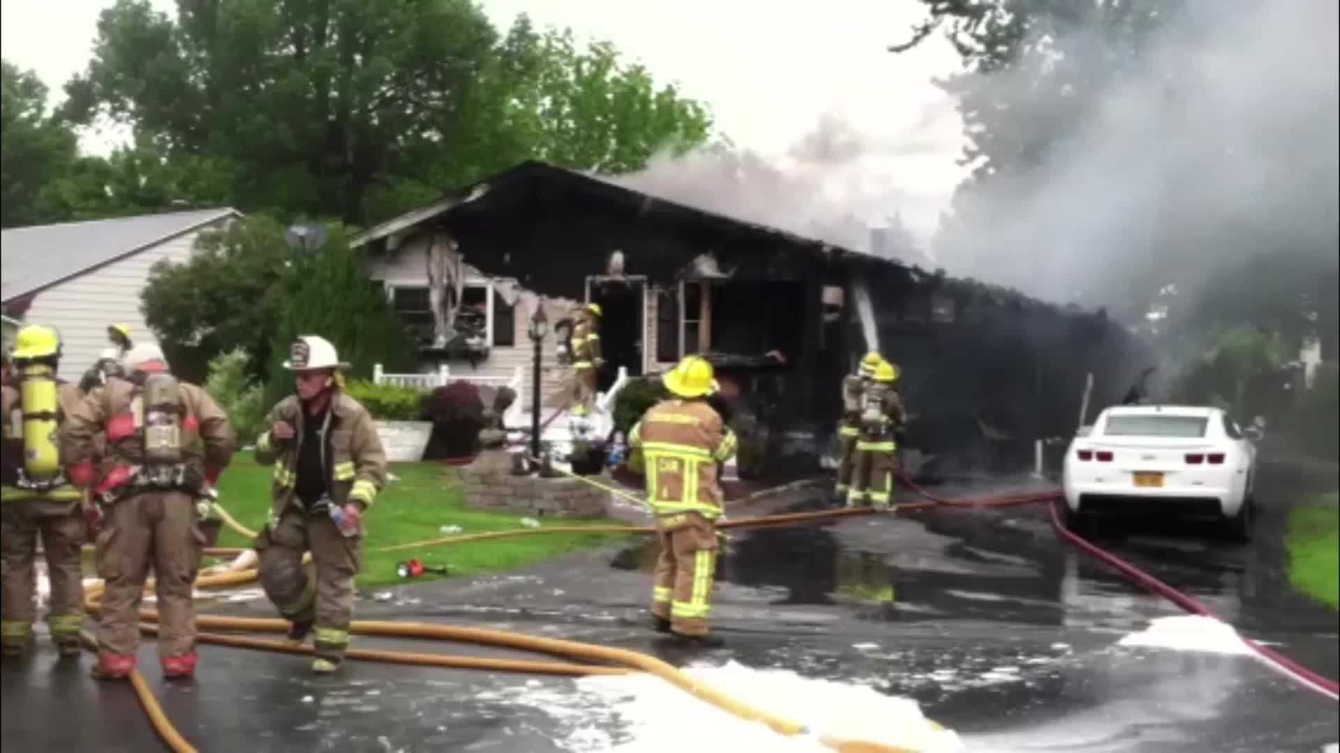 A fire leveled Rouses Point home and the attached garage Monday morning.