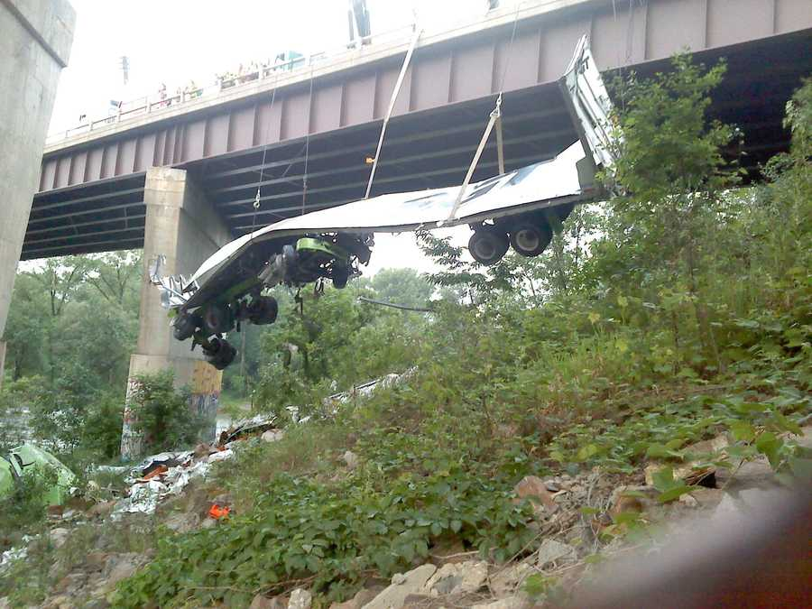 A portion tractor trailer that went off of the Winooski River Bridge of Interstate 89, near Exit 15, is being removed from beneath the bridge.