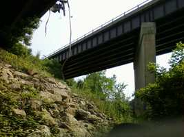 Debris from Monday night's tractor trailer accident along Interstate 89, near Exit 15, is being cleaned up. A tractor trailer went over the Winooski River Bridge and landed in the water below.
