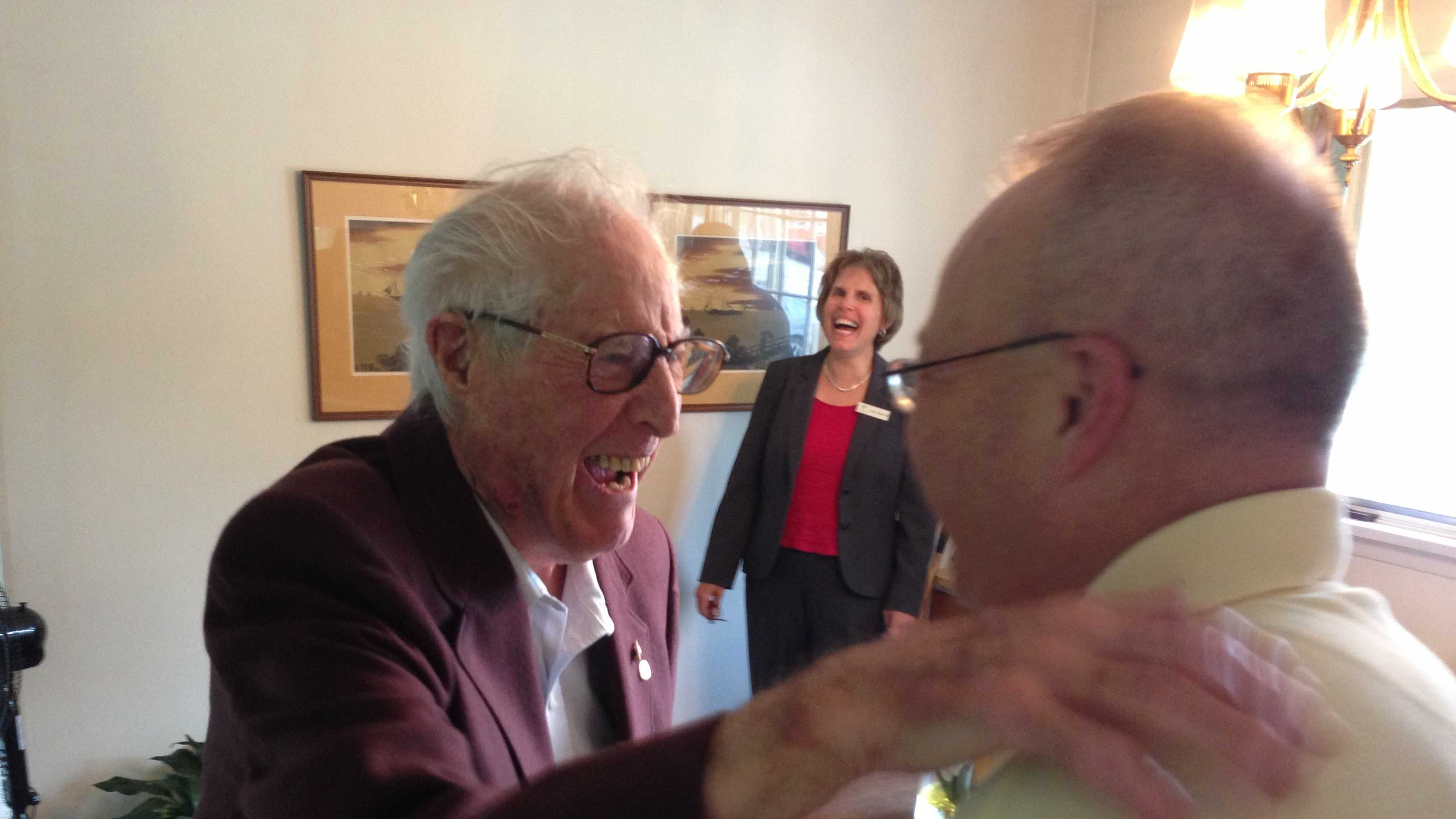 Mo Smith '34 shares a laugh with Norwich University President Richard Schneider Tuesday afternoon.