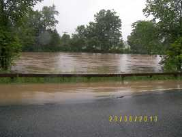 From Facebook User Kevin Donna Gilbert: Photo of East Branch of Au Sable River Route 9N between Au Sable Forks and Jay near Stickney Bridge. River is rising as the photo is being uploaded.