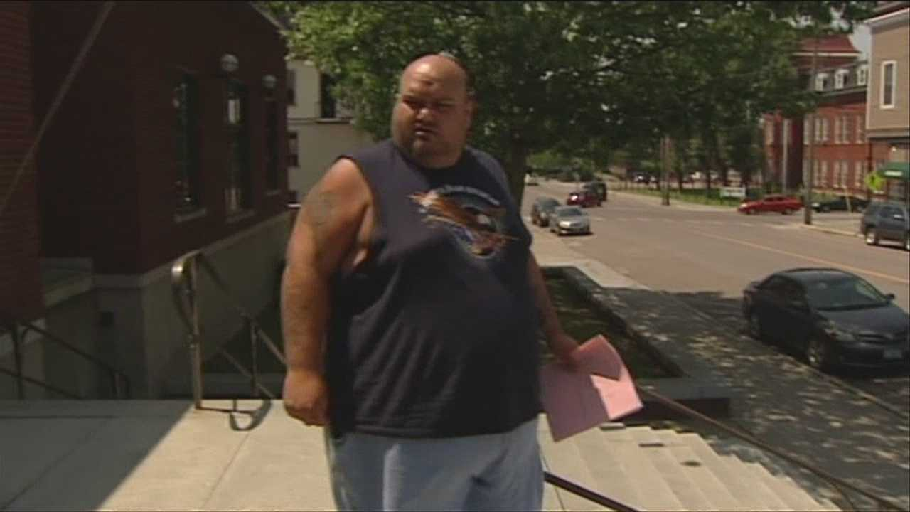A man accused of locking multiple dogs in a sweltering apartment without food or water is charged with animal cruelty.