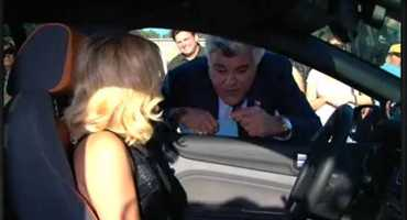 I've been to see the Tonight Show a few times. Jay Leno is more fun in person, I think. Here, he's talking with a bombshell outside the studio and a few of us are trying to hear what they're saying.