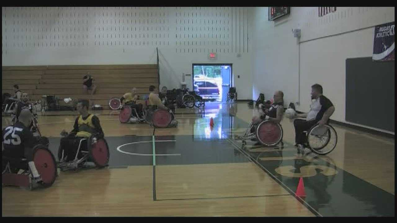 Overcoming serious injuries athletes in wheelchairs face off in rugby game