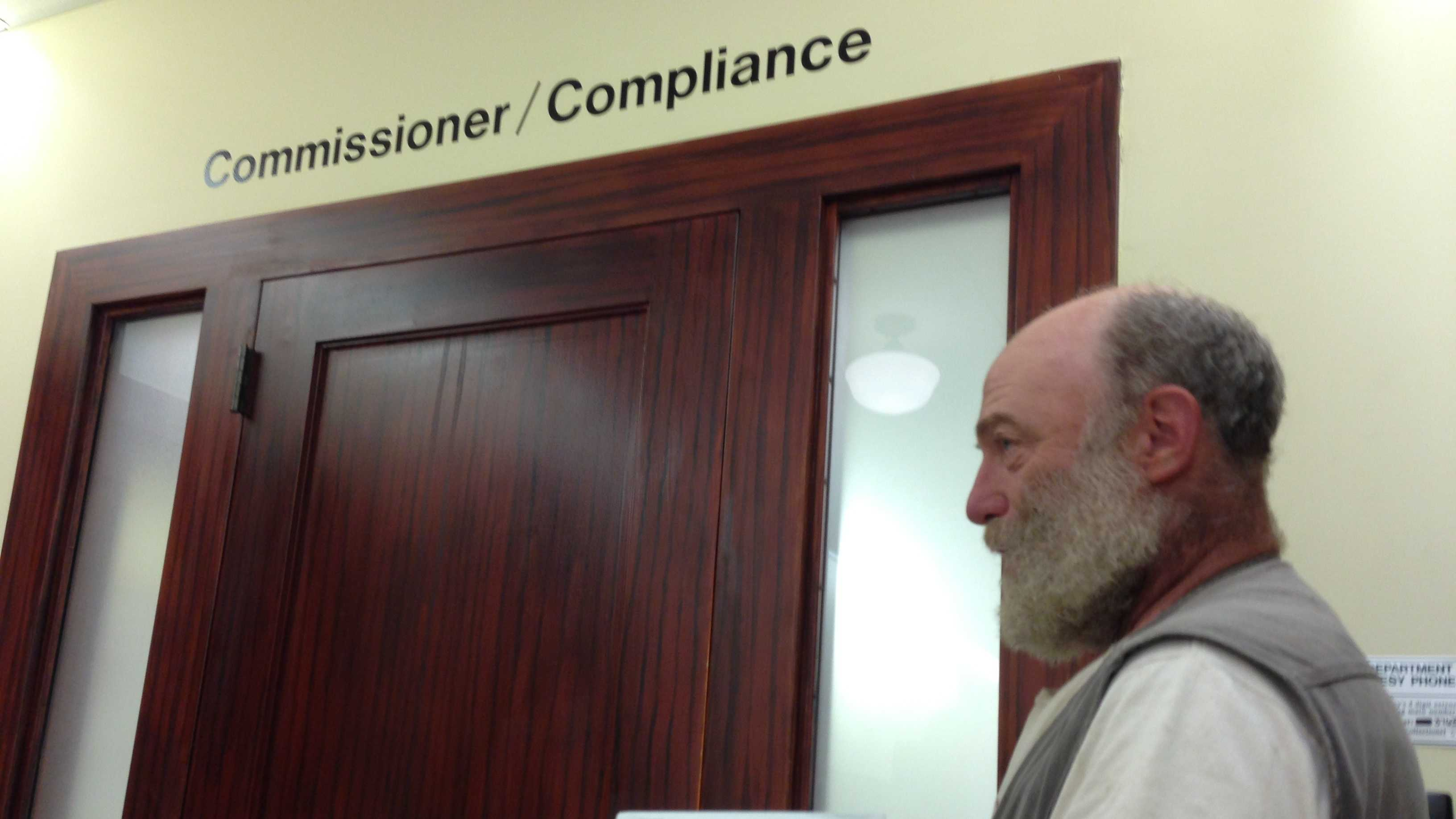 Karl Hammer, president of Vermont Compost Company, drops off his appeal at tax department, which has demanded he pay $115k in back taxes and penalties.