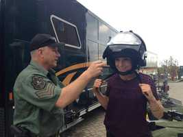 I will never turn down an opportunity to dress up or put something on my head. While doing a story on a Vermont State Police conference, I asked a trooper if I could try on a bomb-proof helmet. This moment made my day.