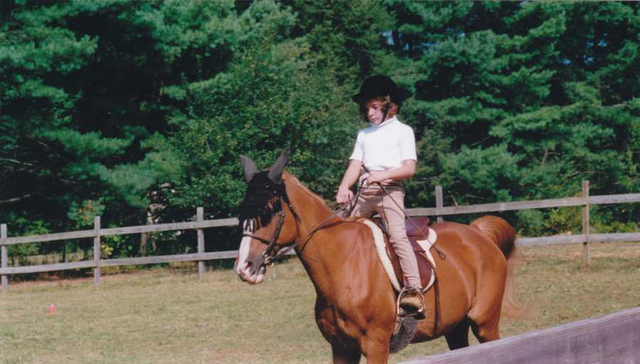 I've been riding horses since I was 6 years old. Here I am trotting on Little Prince, concentrating very hard apparently.