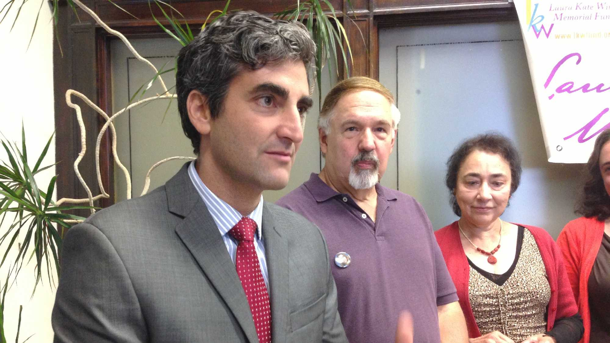 Mayor Miro Weinberger stands with Laura Winterbottom's parents, Ned and JoAnn. Laura, who would have been 40 today, was murdered in 2005. Weinberger is urging public participation in Saturday's charity walk/run to raise money for trio of causes Laura admired.
