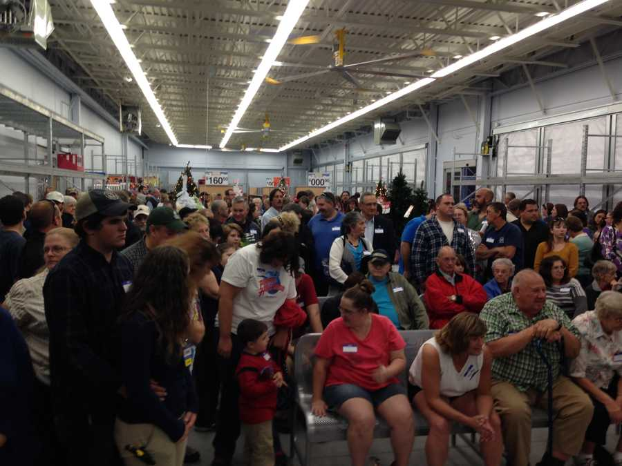 Hundreds of family and friends pack Walmart's garden center for an opening celebration.
