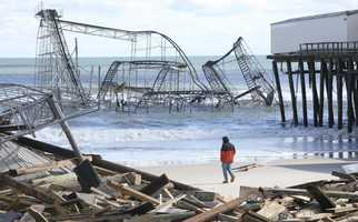A man looks over the debris on the Seaside Heights, N.J., beach near Casino Pier on Wednesday, Oct. 31, 2012.