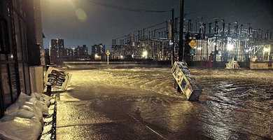 Streets around a Con Edison substation are flooded as the East River overflows into the Dumbo section of Brooklyn, N.Y.