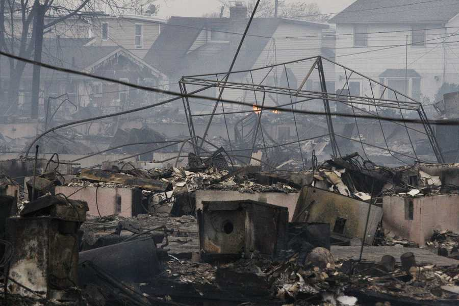 A look at the damage caused by a fire in the New York City borough of Queens. The fire destroyed between 80 and 100 houses in the flooded neighborhood.